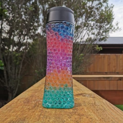 colorful sensory bottle with water beads